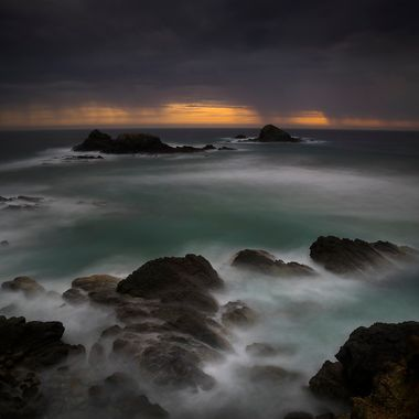 It was a bleak morning and the cloud did drop a little rain. The surf was crashing over the the rocks and the wind was sweeping the spray all over. Terrible weather but it leads to some good photos. One from the top of Broken Head, just after sunrise.