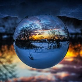 The glass ball turns the world upside down.