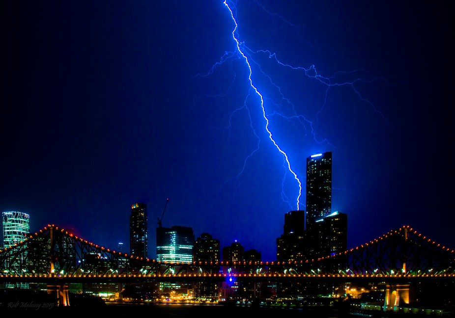 Lightning striking Brisbane City (Australia) with the Story Bridge in the foreground