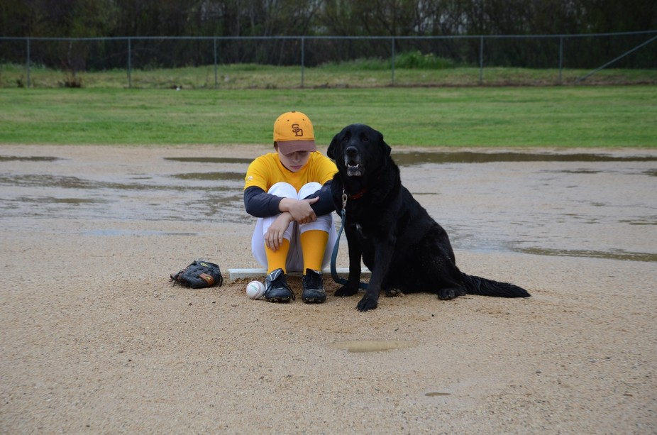 At least he had a dog to console him after the rainout.
