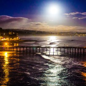 The moon has just begun rising over the small town of Capitola, the light is reflecting off of the water and turning the skies into beautiful hue...