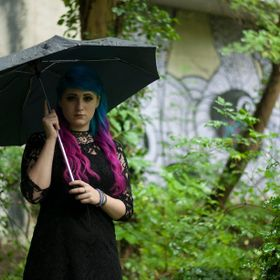 photoshoot of a goth girl on a rainy day