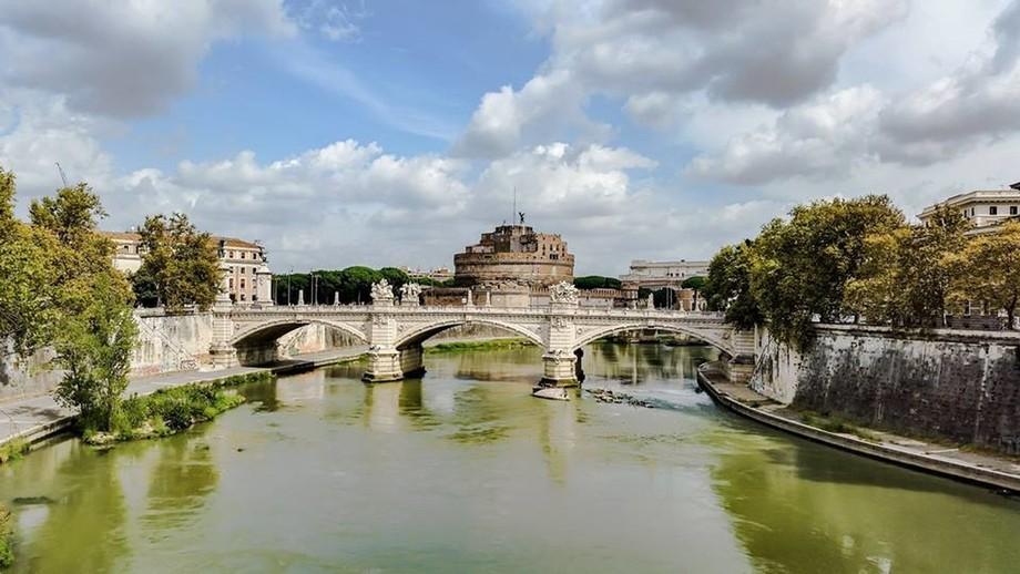 Tevere runs through Roma near San Pietro
