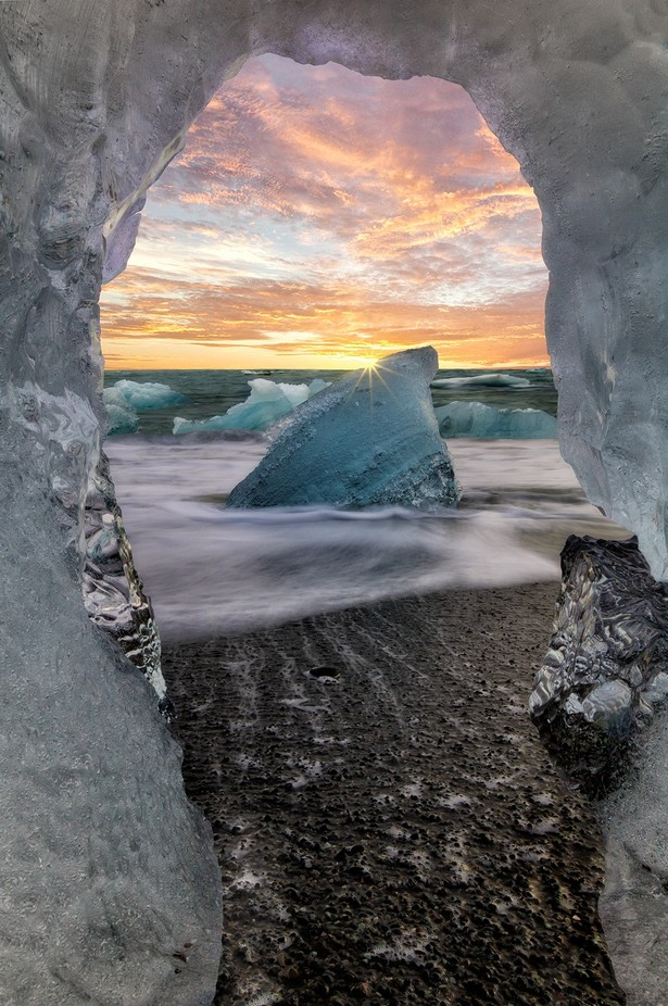 Sunset through the window of ice by jamiemacisaac - The Magic Of Moving Water Photo Contest