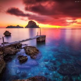 Dramatic sunset at Cala d'Hort, Ibiza, Spain.  Es Vedrà (the island in the photo) and the surroundings are one of the most 3 magnetic field...