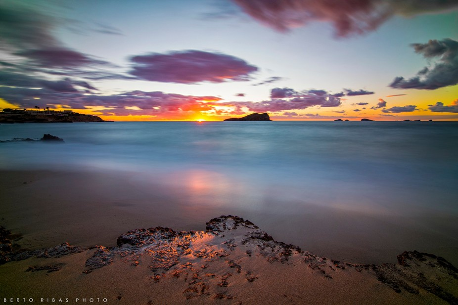 Sunset at Cala Compte's beach in Ibiza, Spain.