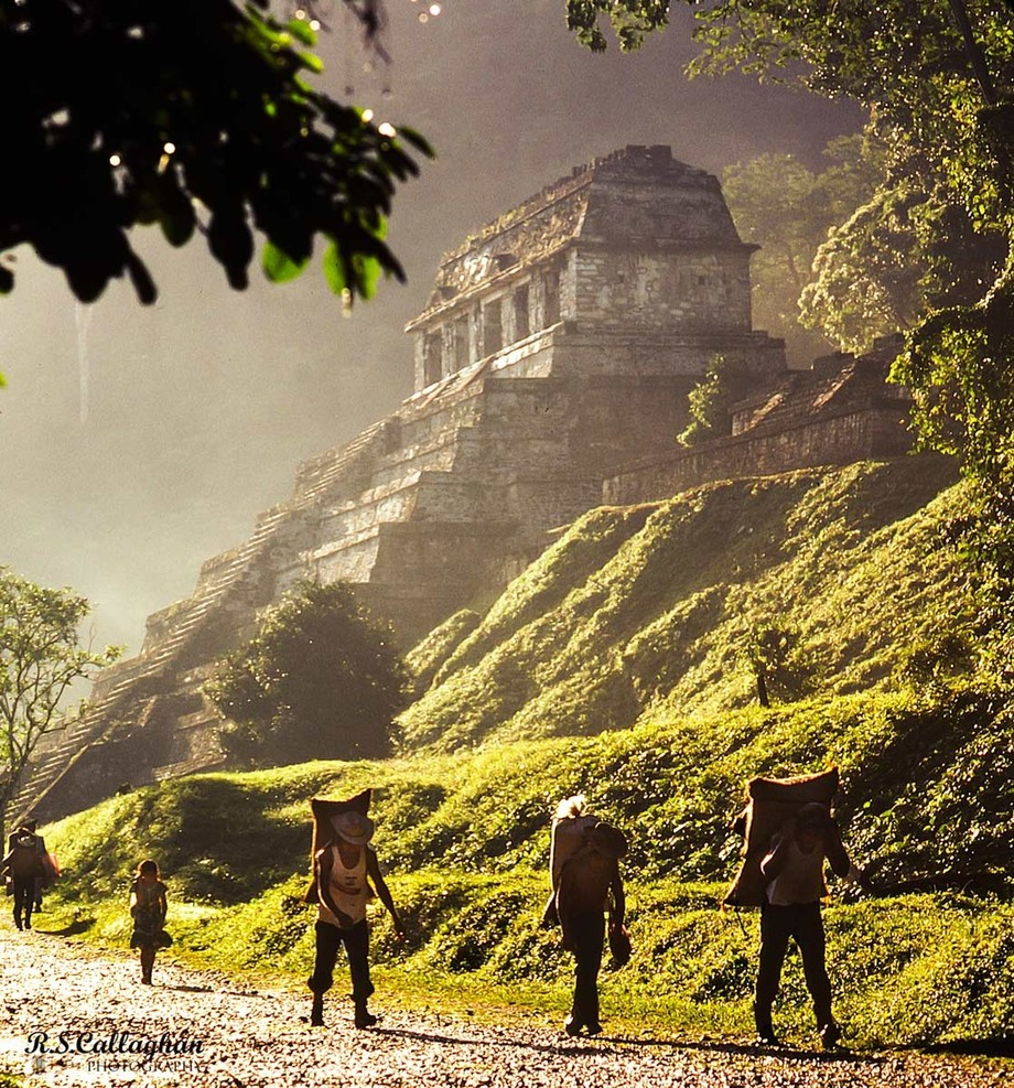 Modern descendants of the Maya walk through the sacred site of Palenque (Chiapas, Mexico) shortly after dawn.