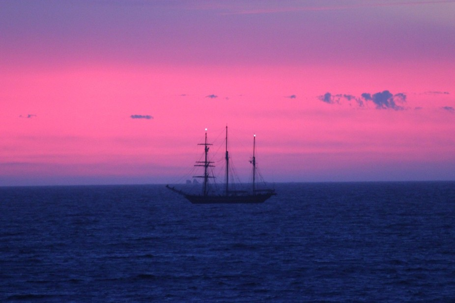 It is a very Amazing photo of a boat it really brings out the colour of the water and cloudy sky.