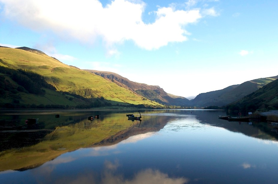 Two days of torrential rain, and then the calm after the storm. No breeze and perfect reflections on the lake