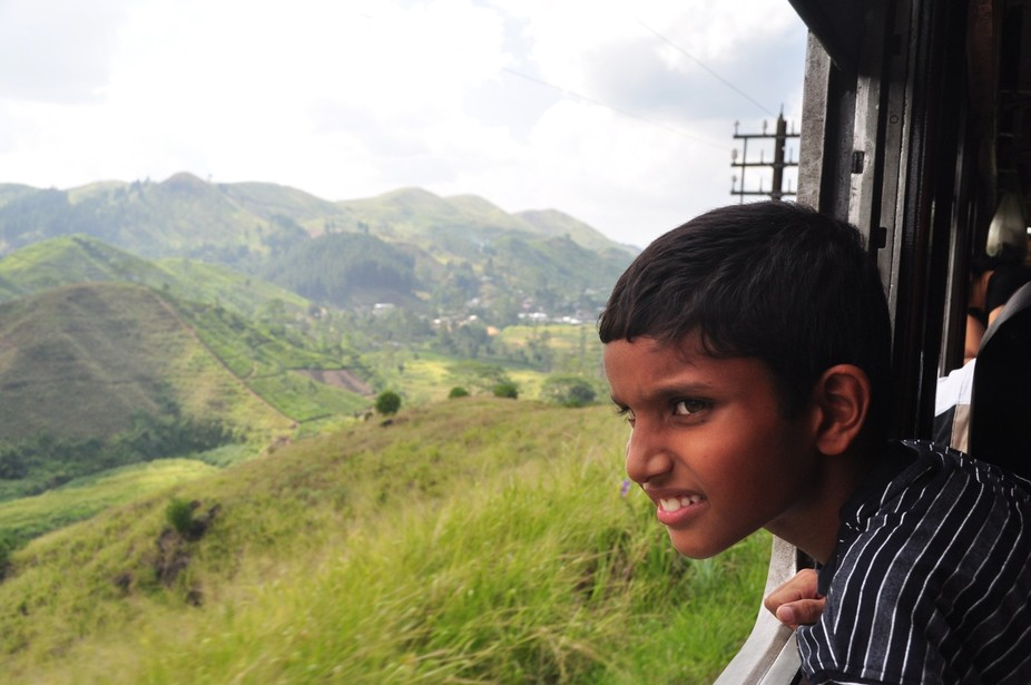 The 4 hour Train ride through the tea plantations of Sri Lanka is endlessly fascinating, and this Sri Lankan boy was not the only one transfixed by the scenery.