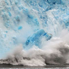 Meare's Glacier Calving Creates a Tidal Wave as an Ice Berg Hits the Ocean.