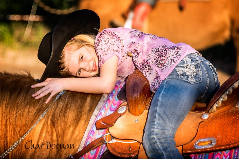 A candid moment at horsemanship practice where I was photographing ten girls. This 6-year-old cut...