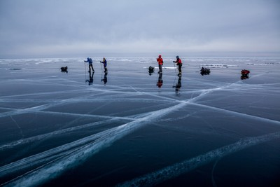 Ice skaters on the ice of lake Baikal