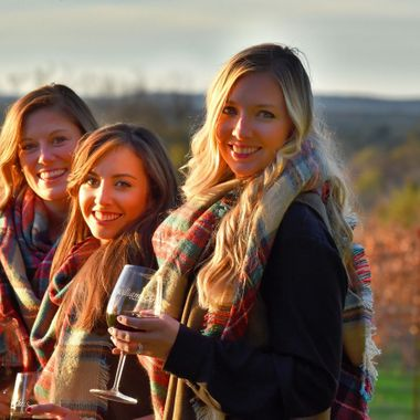 These three ladies found the right time to stroll the vineyard close to sunset, didn't they?