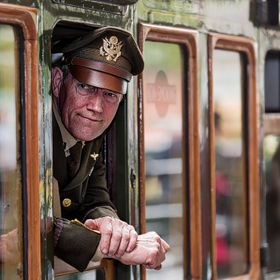 A WW2 Army Air Corps officer looks from a train window.