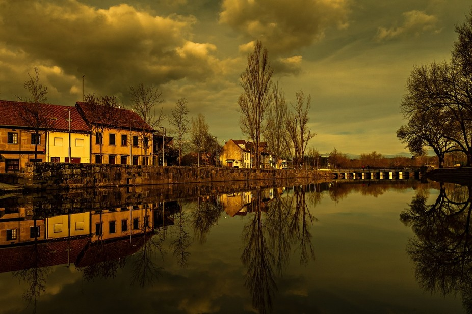 Reflections at sunset on the river Pavia in the city of Viseu.