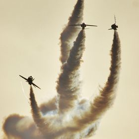 Red Arrows performing smoke trails whilst in practice over their home base at RAF Scampton, England.