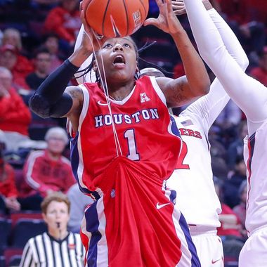 Jan 4, 2014; Piscataway, NJ, USA;  Houston Cougars guard Demetria Foreman (1) drives to the basket but cannot get the shot off because her hand gets caught in her uniform string during the first half at Louis Brown Athletic Center.