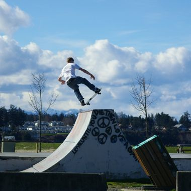 Skateboarder at Parksville Park flying high mid March 2007