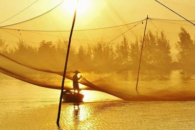 Sunrise on Son Thu Bon River, Hoi An, Vietnam