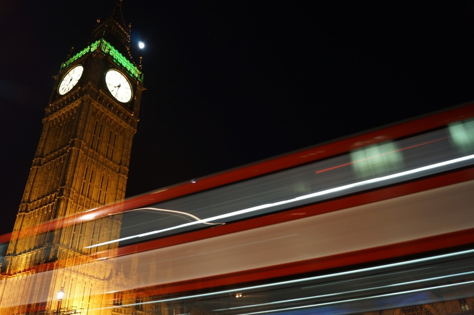 Taken on a night shoot in Westminster of the light trails of a bus passing Big Ben on a shortish ...