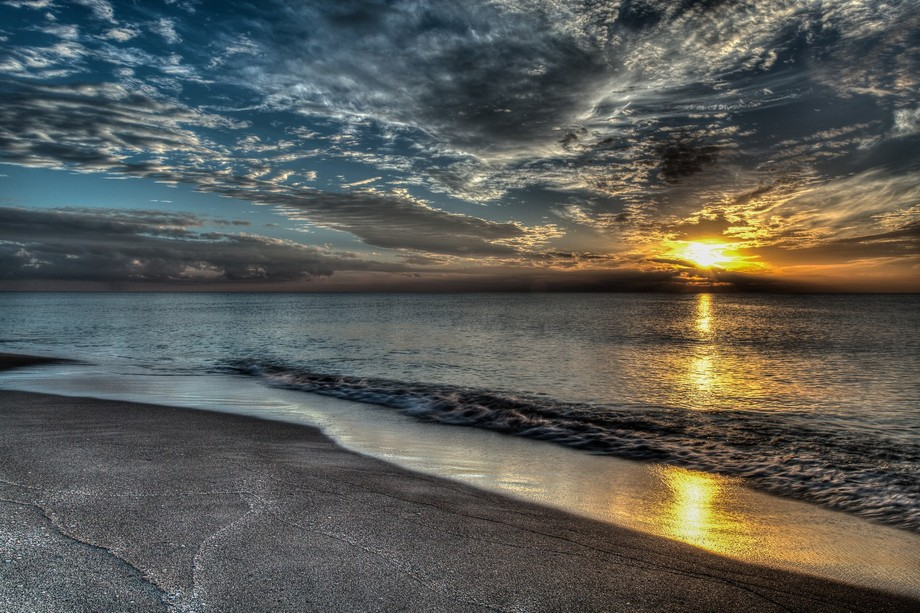 The Sand seemed to take on the V-Shaped pattern of the sky when taking this Sunset on Sanibel Isl...