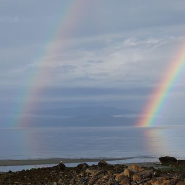 DOUBLE RAINBOW over Qualicum Beach, B.C. on Vancouver Island CANADA