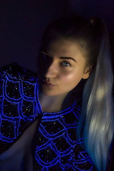 Self-Portrait with a Black Light