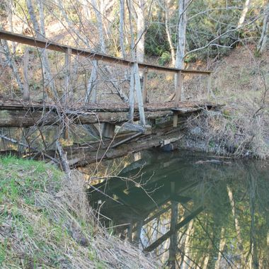 Old Rickety Bridge in Park of Kaye Road in Parksville, BC on Englishman River Feb 23, 2015