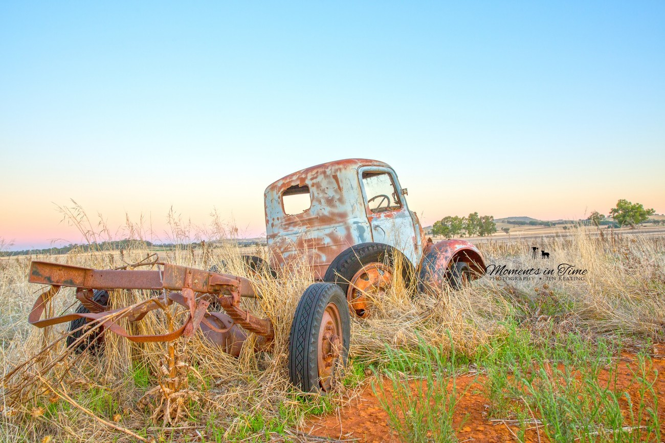 just on dusk ... the old truck rests up in the paddock having seen better days.