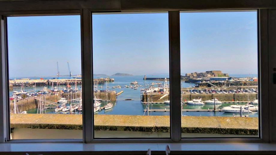 Just a perfect day - sitting having coffee when the condor ferry turned into the harbour. In the distance you see the island of Herm, Jethou and Sark farther away.