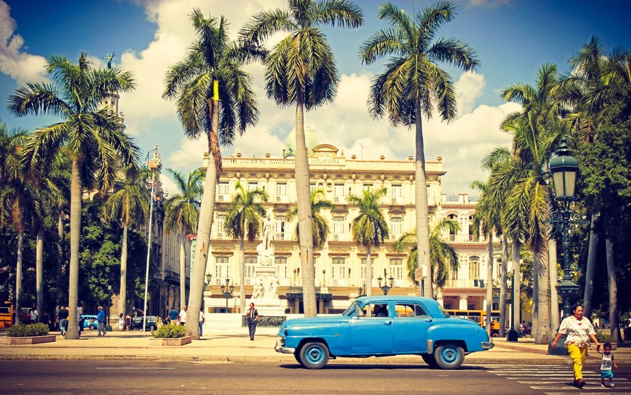 Havana Cuba - Hotel Inglaterra from across square with old blue car