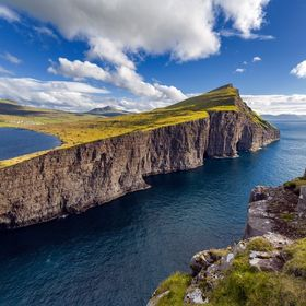 The cliffs of Leitisvatn in the Faroe Islands facing the North Atlantic ocean.
