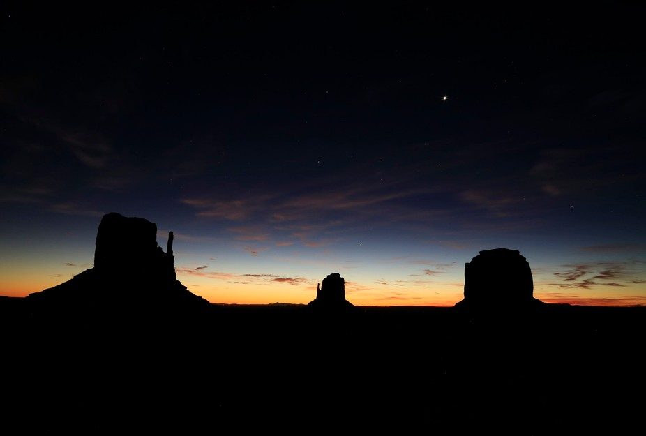 Early morning in Monument Valley we stopped to catch the dawn above the Three Sisters before head...