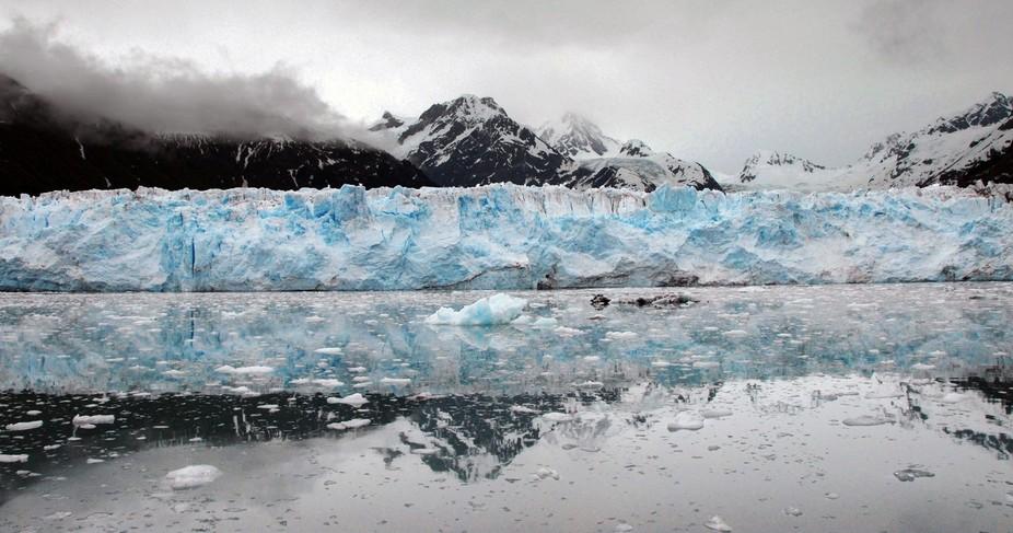 Meare's Glacier, Prince William Sound, Alaska, on a glassy calm, chilly day.