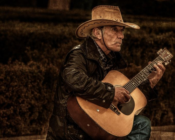 The guitarist of Madrid by ruthchudaska-clemenz - Street Portraits Photo Contest
