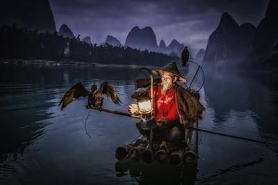 Cormorant fisherman with oil lantern