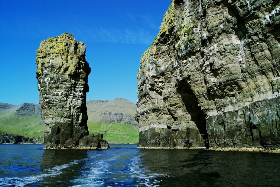 In a fishingboat in The Faroe Islands. We just went through that huge rock on the right.