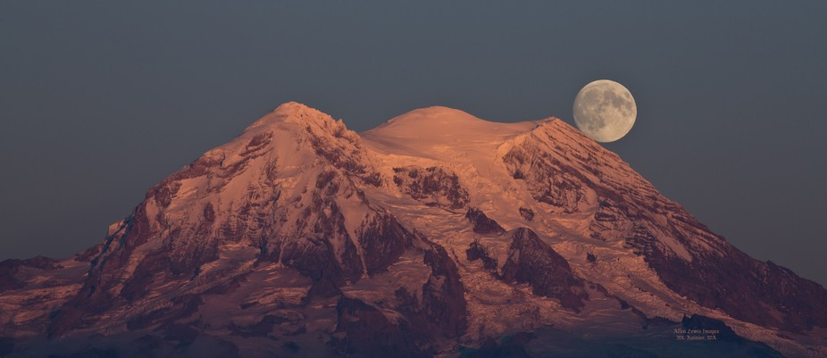 The moon rising above Mt Rainier at sunset the day before the Blood Moon.  I used my TPE APP to  ...