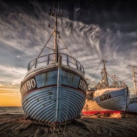 Three fishing ships at Thorup Strand in Denmark.