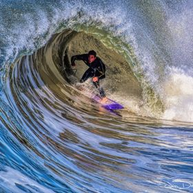 A Surprised Surfer inside a Barrel