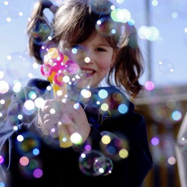 Little girl and her Bubble gun