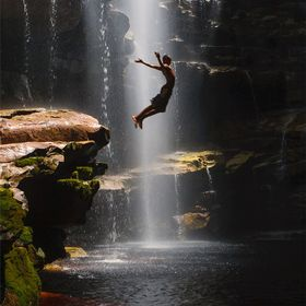 A brazilian guy dives into the Mixila waterfall's pool, Chapada Diamantina N.P., Bahia, Brazil.