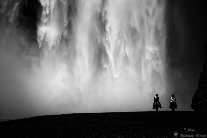 Looking at the waterfall by Geinis - People And Waterfalls Photo Contest