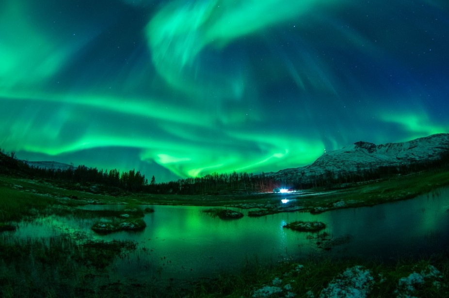 A frozen swamp provided some reflection for the northern lights. They were so bright it was possi...