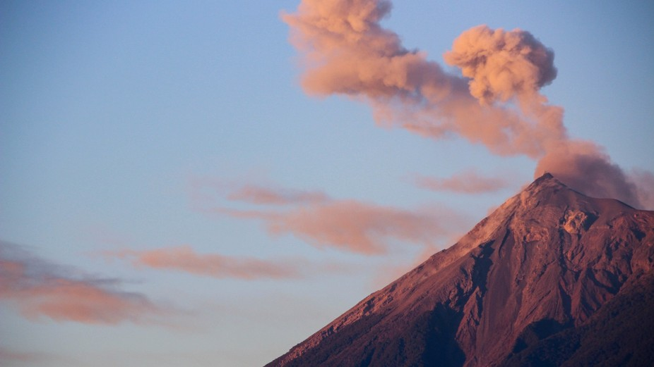 Volcan de Fuego puffing away in the light of an early sunrise.