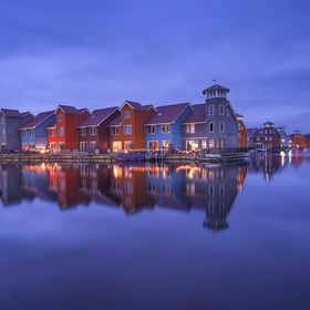 The color beauty of the Rainbow house in the marina close to Reitdiephaven attracted my sense to captured.  On the northwest edge of the city of ...