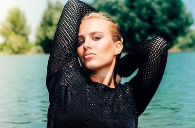 Beautiful blonde woman in water.