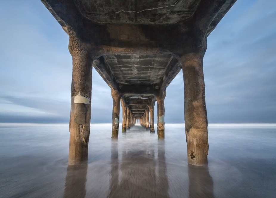 An early morning shot under the pier at Manhattan Beach, CA