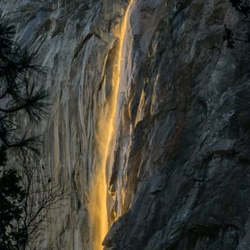 The sunset lights up just the falls and not the surrounding cliffs creating the effects of fire falling off the mountain.  This only happens for ...